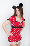 Close-up beautiful young leggy brunette in a very short red dress with white polka dots Stock Photography