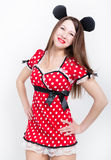 Close-up beautiful young leggy brunette in a very short red dress with white polka dots Stock Photos