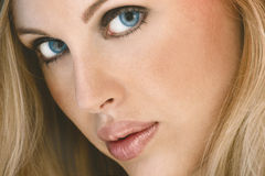 Close up of beautiful young woman with blue eyes Stock Photography