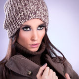 Close up beautiful young woman with brown cap Royalty Free Stock Photo