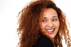 Close up beautiful young woman with curly hair laughing against isolated white background. Close up portrait of beautiful young woman with curly hair laughing royalty free stock images