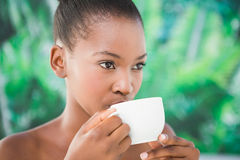 Close up of a beautiful young woman drinking coffee Royalty Free Stock Images