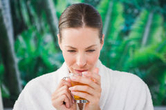 Close up of a beautiful young woman drinking tea Stock Photo