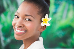 Close up a beautiful young woman with flower in her hair Royalty Free Stock Photography