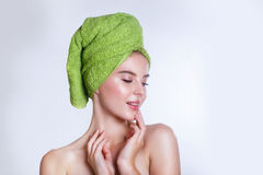 Close-up of beautiful young woman with green bath towel. Spa concept Royalty Free Stock Photo