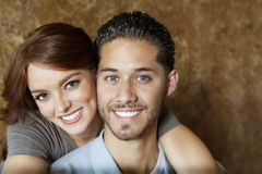 Close-up of beautiful young woman hugging man from behind Royalty Free Stock Photography
