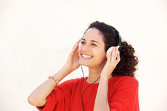 Close up beautiful young woman listening to music with headphones against white background. Close up portrait of beautiful young woman listening to music with Stock Images