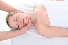 Close-up of beautiful young woman receiving massage at health sp royalty free stock photos