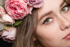 Close up of beautiful young woman in rose wreath Stock Images