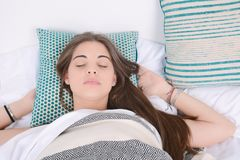 Woman sleeping on bed. Stock Photography