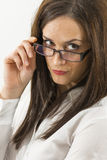Close up of beautiful young woman wearing eyeglasses isolated Royalty Free Stock Image