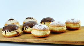 Close up. Beautifully arranged delicious doughnuts with icing, s stock images