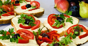 Close up on beautifully decorated tray with vegetarian sandwich garnished with tomatoes and parsley. Royalty Free Stock Image