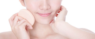 Close-up of beauty applying foundation by sponge Stock Photography