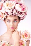 Beautiful  girl with flowers hair, makeup and silk skin,looking at camera Royalty Free Stock Image