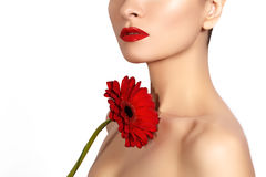Close-up beauty photo woman with red lips, lipstick and beautiful red flower. Spa clean skin stock image