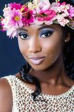 Face shot of young african bride with floral crown. Royalty Free Stock Photography