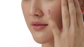 Close up portrait of beautiful young asian woman touching face and healthy skin in slow motion skincare concept. Close up beauty portrait of beautiful young stock video