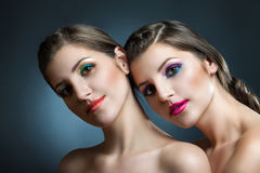 Close-up beauty portrait of two beautiful young women Royalty Free Stock Image