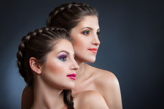 Close-up beauty portrait of two beautiful young women Royalty Free Stock Photo