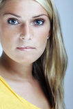 Close-up beauty portrait of a young blond woman royalty free stock photography