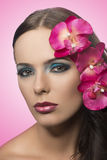 Pretty brunette with flowers. FLOWERS ARE FAKE Stock Images