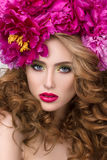 Close-up beauty portrait of young pretty girl with flower wreath. In her hair wearing bright pink lipstick. Bright modern summer makeup. Beauty, spa and Royalty Free Stock Images