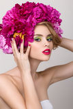 Close-up beauty portrait of young pretty girl with flowers in he Royalty Free Stock Photo