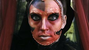 Close-up beauty red art make-up portrait of halloween woman Witch baroque. stock video footage