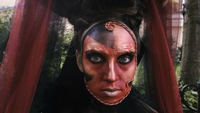 Close-up beauty red art make-up portrait of halloween woman Witch baroque. stock video
