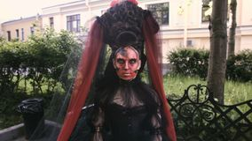Close-up beauty red art make-up portrait of halloween woman Witch baroque. stock footage