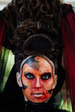 Close-up beauty red art make-up portrait of halloween woman Witch baroque. Stock Image