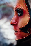 Close-up beauty red art make-up portrait of halloween woman Witch baroque. Royalty Free Stock Image
