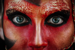 Close-up beauty red art make-up portrait of halloween woman Witch baroque. Close-up Macro eyes. Red art make-up portrait of halloween woman Witch baroque. Face Stock Images