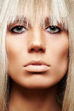 Close-up of beauty with strict hairstyle & make-up. Front view beauty close-up face of fashoin tanned woman wich wearing sexy hairstyle with fringe, brown eye Stock Image
