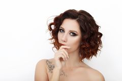 Close up beauty studio shot of beautiful redhead woman with gorgeous makeup curly hair Royalty Free Stock Image