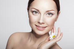 Close-up Beauty Woman Face. Perfect Skin.Body care. Beautiful Girl With Camomile Flowers.Close-up Beauty Woman Face. Perfect Skin.Body care. Professional Make Stock Photo