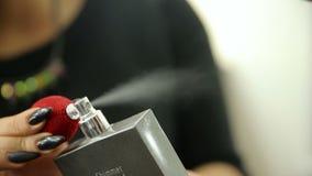 Close up beauty woman portrait with parfume. Against white