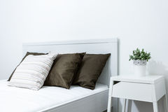 Close-up of bed. Close-up of comfortable bed in modern bedroom Stock Photos