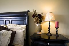 Close up on a bed and the nightstand in a bedroom Royalty Free Stock Photo