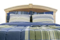 Close Up of Bed Over White Stock Images