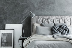 Close-up, bedroom with gray headboard royalty free stock photos