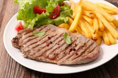 Beef and french fries. Close up on beef and french fries Stock Photography