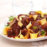 Close up of beef goulash and noodles Royalty Free Stock Images