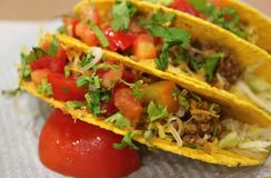 Close up of beef tacos with salsa sauce, tasty Mexican fast food. Texture Background stock photography