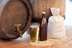 Close up of beer barrel, glass, bottle and malt Royalty Free Stock Photos