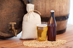 Close up of beer barrel, glass, bottle and malt Royalty Free Stock Photo