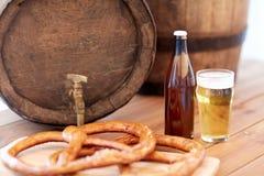 Close up of beer barrel, glass, pretzel and bottle Royalty Free Stock Image