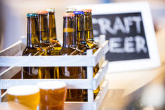 Close-up of beer bottles in crate Stock Photos
