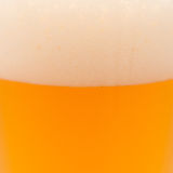 Close up of beer with foam Stock Photography